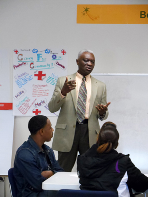 Tunde Eboda speaking at the UPO Workforce Readiness Training class