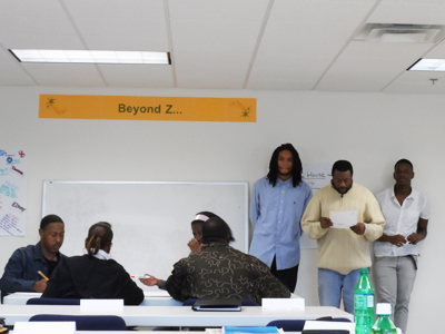 Workforce Readiness Training class participants deliver a presentation about their business plan