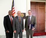 Photo of Arley Johnson, Bob Scott, and Representative Tonko pose outside of the briefing room